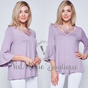 Soft stretchy criss cross neck top